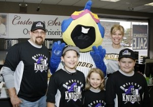 Boomer poses with members of the Mercer Knights and Debbie Schaeffer, owner of Mrs. G TV & Appliances. Mrs. G's is a proud sponsor of the Mercer Knights.